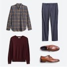 Stitch Fix men's clothes including a blue and tan plaid shirt, grey pants, burgundy sweater and brown leather dress shoes.