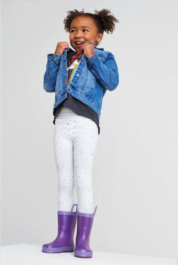 Denim jacket, grey top, white pants and purple rain boots.