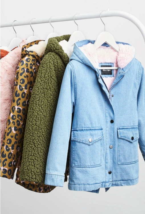 A rack of jackets including denim, green fleece, leopard print and pink.