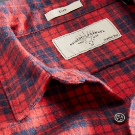 Close up image of a red and blue plaid shirt label.