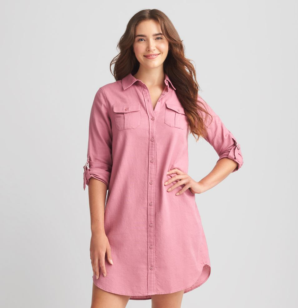 Pink shirt dress with collar and pocket detail.