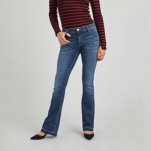 Red and black striped shirt and bootcut jeans with black pointed toe heels.