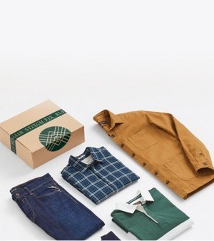 Stitch Fix box, jeans, sport shirt, plaid shirt and tan coat.