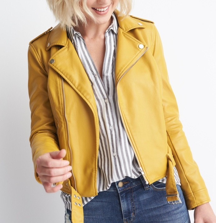 Yellow leather crop jacket over a white and light blue striped blouse.