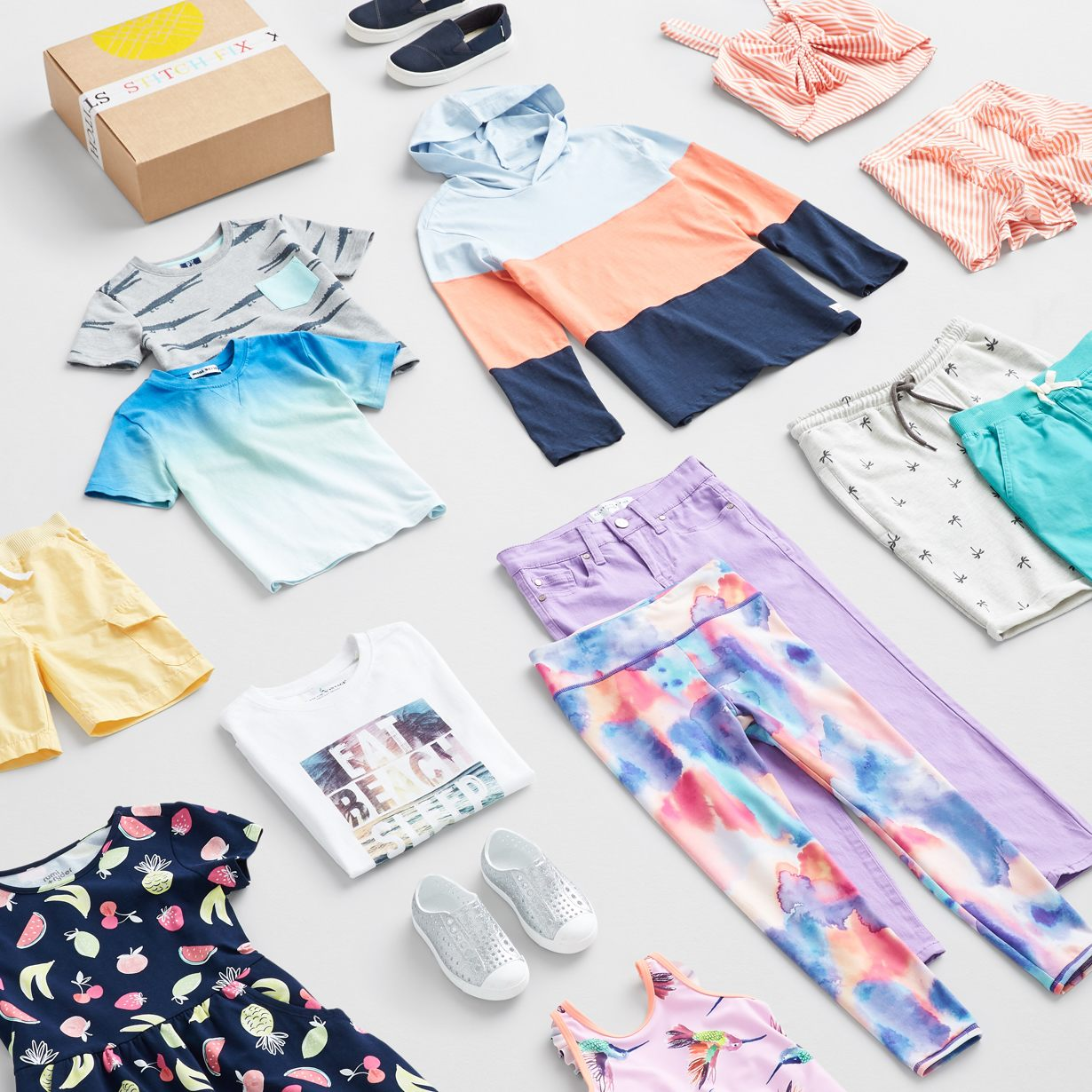 Various clothing styles with a Stitch Fix box.