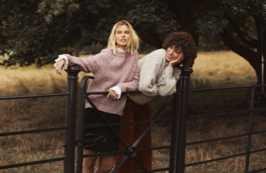 Outfits including a pink jumper and black skirt, and cream jumper with dark trousers.