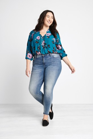 Stitch Fix women's clothes including tea floral top, jeans and black flat shoes.